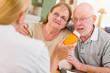 Doctor or Nurse Explaining Prescription Medicine to Senior Adult Couple