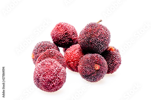 Red bayberry with white background.. Wallpaper Mural