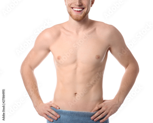 Young man with slim body in towel on white background, closeup Fototapeta