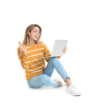 Young Woman In Casual Outfit With Laptop Sitting On White Background