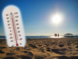 thermometer showing the temperature rise in the summer sun and seaside photo koncept