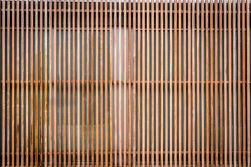 Wall of thin wooden slats, vertical parallel plates. Empty background