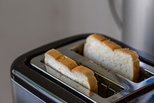 Toaster And Two Hot Toasts Ready To Eat
