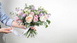 Florist holding a bouquet. Beautiful spring flowers. Arrangement with mix flowers. The concept of a flower shop, a small family business. Work florist. copy space