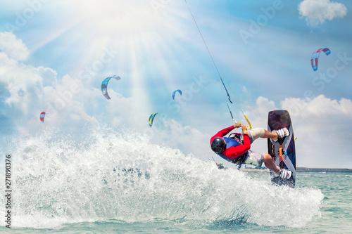 Obrazy Kitesurfing   kitesurfing-man-rides-on-kite-on-waves-at-sunny-day
