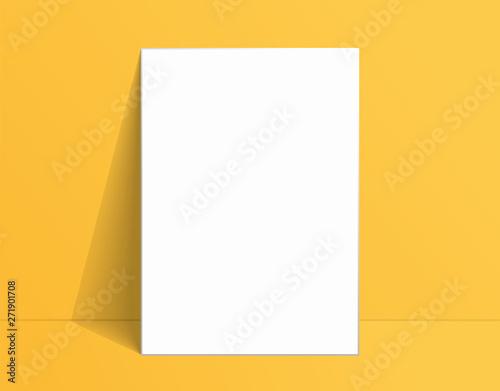Fotografie, Obraz  White poster mockup standing on the floor near yellow wall