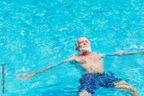 fototapeta na drzwi i meble Healthy elder enjoy relax swimming in the pool alone vacation holiday
