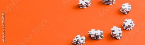 Obraz panoramic shot of stacks with white puzzle pieces on orange - fototapety do salonu