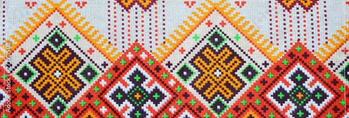 Fotografija  Traditional Ukrainian folk art knitted embroidery pattern on textile fabric
