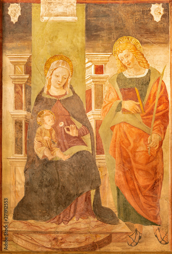 COMO, ITALY - MAY 11, 2015: The fresco of Madonna with the St. Ursula in church Chiesa di San Orsola by Andrea de' Passeris (1496).