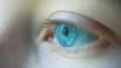 Close-up Macro Shot of female Human blue green opening Eye