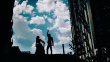 A Young Guy And A Girl Dancing Against A Beautiful Sky. Stunning Clouds In The Background. Two Lovers Spinning In The Dance. Beautiful Dance Of Love