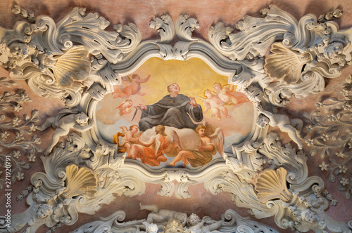 COMO, ITALY - MAY 10, 2015: The baroque fresco of St. Nicholas of Tolentino in side nave of church Chiesa di San Agostino by Morazzone from 16. cent.