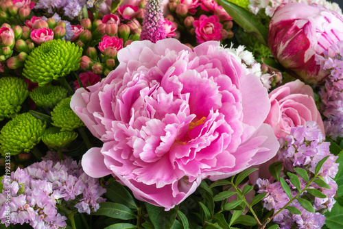 Fotografie, Obraz  pink peony in a colorful spring flower bouquet with chrysanthemums, kalanchoes,