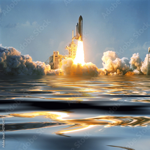 Water and fascinating liftoff of the rocket. Rocket shuttle spaceship is lifting from earth. Elements of image furnished by NASA.