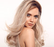 Leinwandbild Motiv Ombre blond wavy hair. Beauty fashion blonde woman portrait. Beautiful girl model with makeup, long healthy hairstyle posing isolated on studio white background.