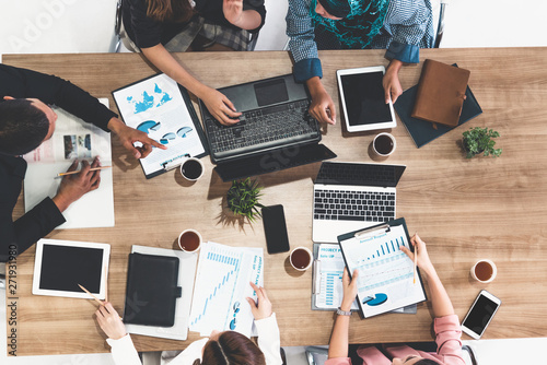 Fototapety, obrazy: Top view of businessman executive in group meeting with other businessmen and businesswomen in modern office with laptop computer, coffee and document on table. People corporate business team concept.