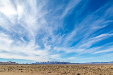 Wispy Clouds Over A Vast Desert Landscape, Along The Extraterrestrial Highway In Nevada