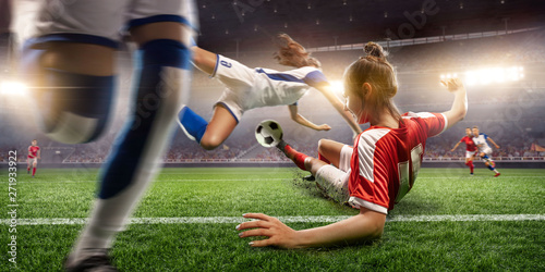 Female Soccer players performs an action play on a professional soccer stadium. Girls playing soccer - 271933922