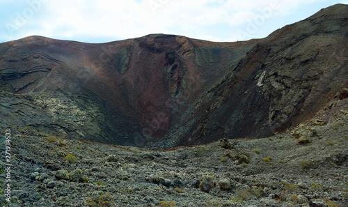 Spoed Foto op Canvas Grijze traf. Volcanic crater in landscape of Timanfaya park Lanzarote.