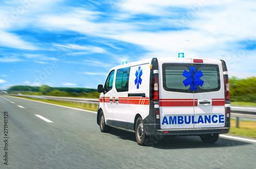 Photo Ambulance van on highway with flashing lights