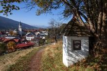 Wayside Shrine On Calvary Chapel Path, Autumn, Bad Hindelang And Parish Church Of St. John The Baptist Behind, Allgau, Bavaria, Germany, Europe