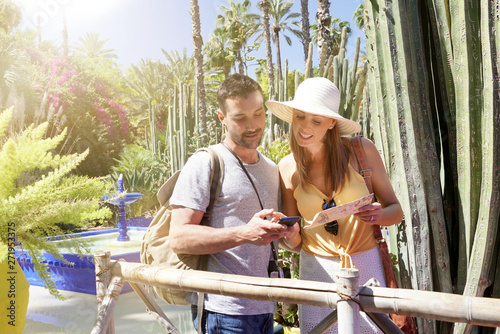 Couple exploring stunning Majorelle Gardens in Morocco Wallpaper Mural