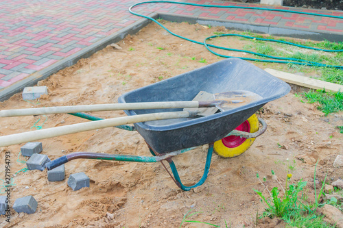 construction site with wheel barrow and spades. Canvas Print