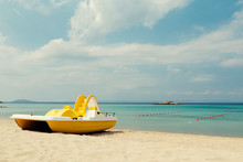 Yellow Pedal Boats On A Turquo...