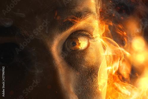 Fotomural Frau sieht ins Feuer