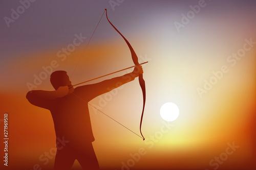 Photo Concept du succès en atteignant son objectif, avec un tireur à l'arc qui bande son arc avant de décocher sa flèche en direction de sa cible