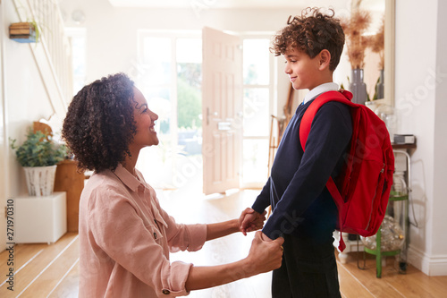 Single Mother At Home Getting Son Wearing Uniform Ready For First Day Of School Wallpaper Mural