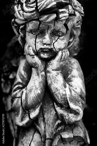Fotografering Old and Cracked Statue of Cherub Little child