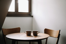 Two Cups On Wooden Table. Dining Room With Table And Two Chairs. Modern Minimal Scandinavian Nordic Interior. Morning Coffee