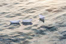 Three Paper Boats Floating In ...
