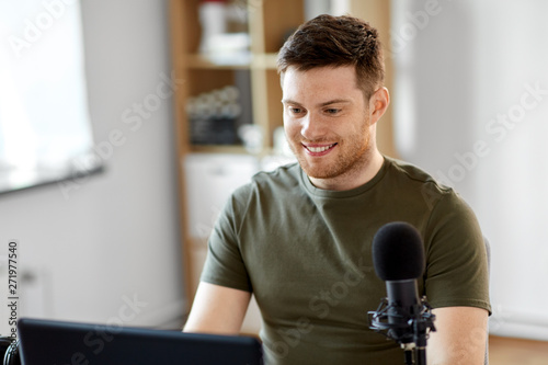 Fotografia, Obraz  technology, mass media and podcast concept - happy young male audio blogger with