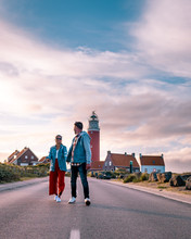 Couple Lighthouse Texel Netherlands, Men And Woman On Vacation Dutch Island Texel