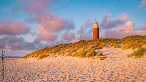 Poster Mer coucher du soleil Lighthouse texel Island Netherlands, Lighthouse during sunset on the Island of Texel