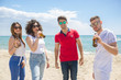 Group of friends close up with sunglasses celebrate the Summer at beach with beer