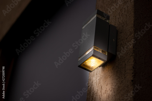 Fotomural Cubical looking lantern placed on the exterior of a building during night time w