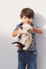 Little Children And Pet Puppy Cat In Outdoors Image
