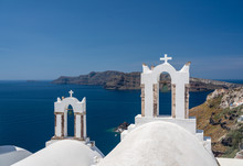 Traditional Greek Orthodox Church With Bell Tower In Village Of Oia On Santorini
