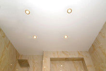 Opaque Stretch Ceiling With Dot Lamps In The Bathroom