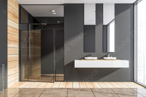 Dark gray and wooden bathroom, sinks and shower