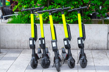 Modern сity Transport - Five Electric Scooters Are Parked On The Street Of The City.