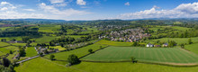 Aerial Panoramic View Of Typical British Farmers Fields And Some Sheep, Captured With The Town Of Usk In  The Background In South Wales, UK