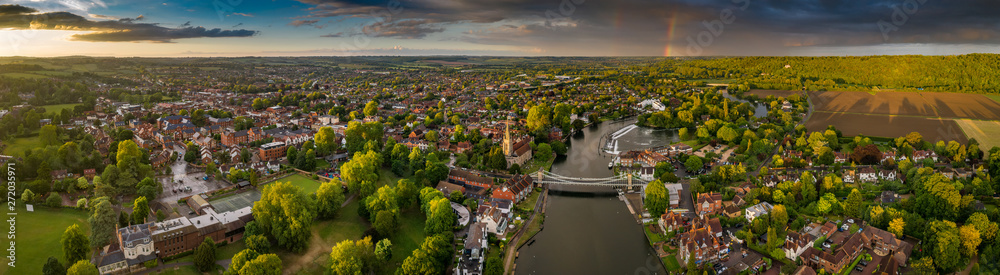 Fototapety, obrazy: Dramatic aerial panoramic view of the beautiful town of Marlow in Buckinghamshire UK, captured after a rain storm, with a rainbow on the horizon