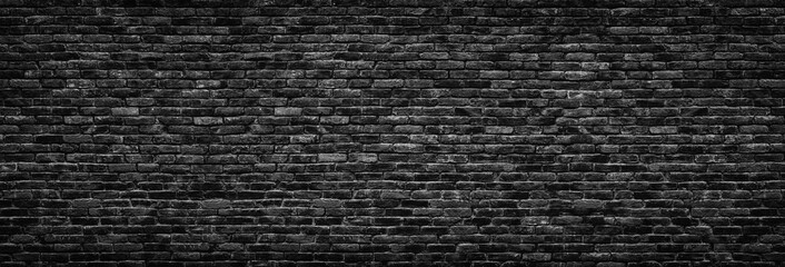 Fototapeta Grunge Black brick wall background. stonework texture gloomy, panoramic view