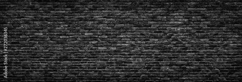 Foto op Plexiglas Historisch geb. Black brick wall background. stonework texture gloomy, panoramic view
