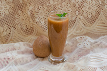 Sapodilla Juice And Fruit Side View